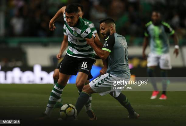 Sporting CP midfielder Rodrigo Battaglia from Argentina with Vitoria Setubal midfielder Joao Costinha from Portugal in action during the Primeira...