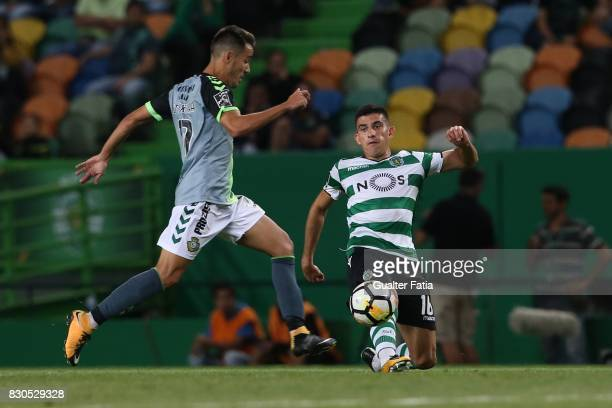 Sporting CP midfielder Rodrigo Battaglia from Argentina with Vitoria Setubal midfielder Joao Teixeira from Portugal in action during the Primeira...