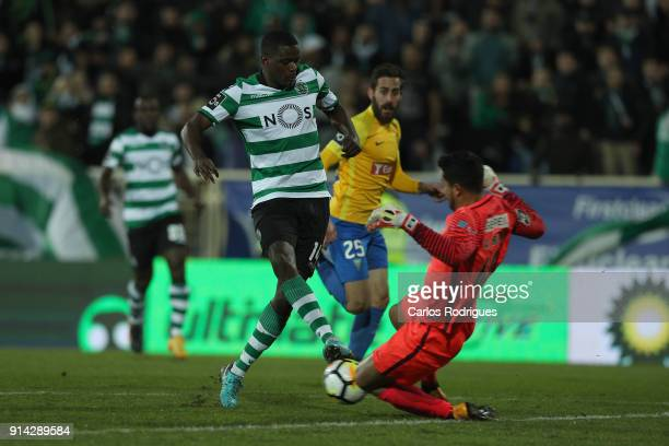 Sporting CP midfielder William Carvalho from Portugal vies with GD Estoril Praia goalkeeper Renan Ribeiro from Portugal for the ball possession...