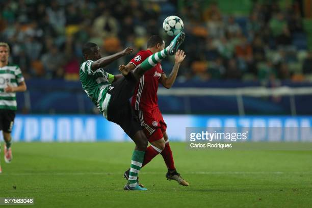 Sporting CP midfielder William Carvalho from Portugal vies with Olympiakos Piraeus midfielder Felipe Pardo from Colombia for the ball possession...