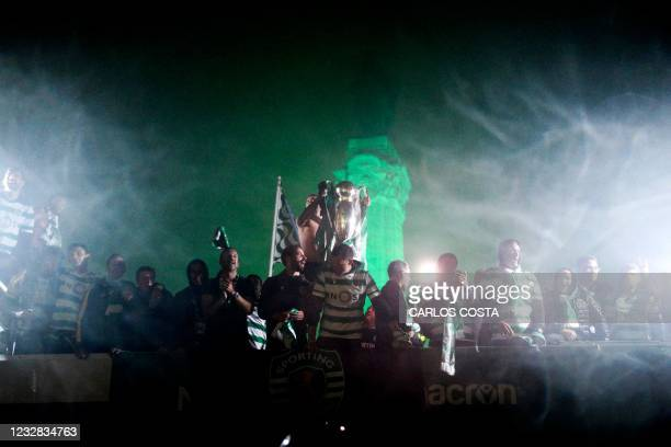 Sporting CP players celebrate in a truck a after winning the Portuguese football League title at Marques de Pombal in Lisbon, early on May 12, 2021....
