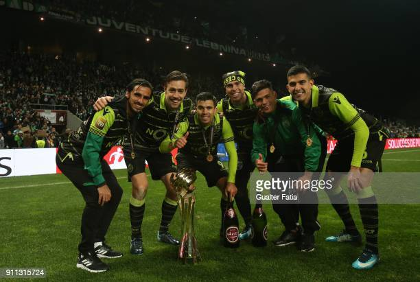 Sporting CP players celebrate with the trophy after winning the Portuguese League Cup at the end of the Portuguese League Cup Final match between...