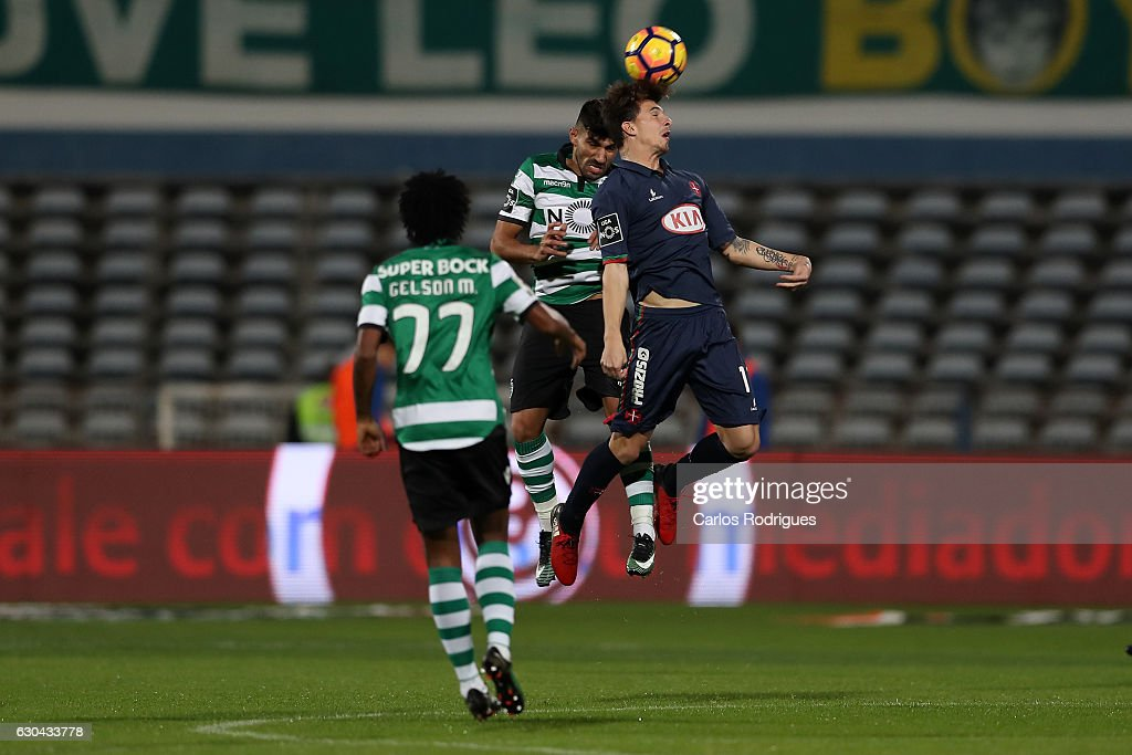 Sporting CPO's defender Ricardo Esgaio (B) vies with Belenenses's forward Fabio Sturgeon from Portugal (F) during the Portuguese Primeira Liga between CFO's Belenenses v Sporting CP - Primeira Liga at Estadio do Restelo on December 22, 2016 in Lisbon, Portugal.