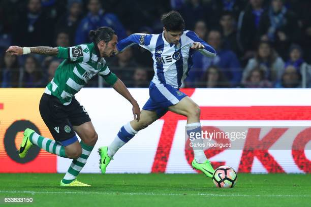 Sporting CP's defender Ezequiel Schelotto from Argentina tries to stop FC Porto's midfielder Joao Carlos Teixeira during the FC Porto v Sporting CP...