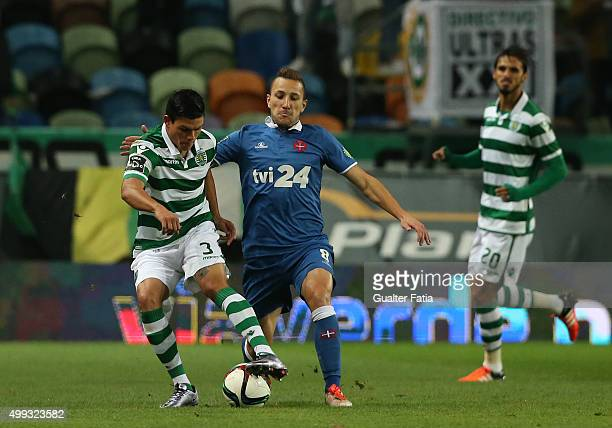 Sporting CP's defender Jonathan Silva with Os Belenenses midfielder Andre Sousa in action during the Primeira Liga match between Sporting CP and Os...