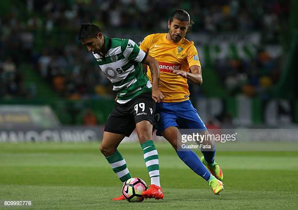 Sporting CP's forward Alan Ruiz from Argentina with Estoril's midfielder Mattheus Bebeto from Brazil in action during the Primeira Liga match between...