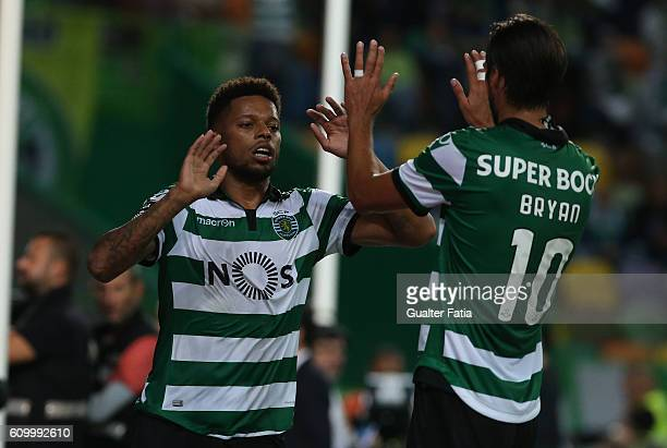 Sporting CP's forward Andre Souza from Brazil celebrates with teammate Sporting CP's forward Bryan Ruiz from Costa Rica after scoring a goal in...