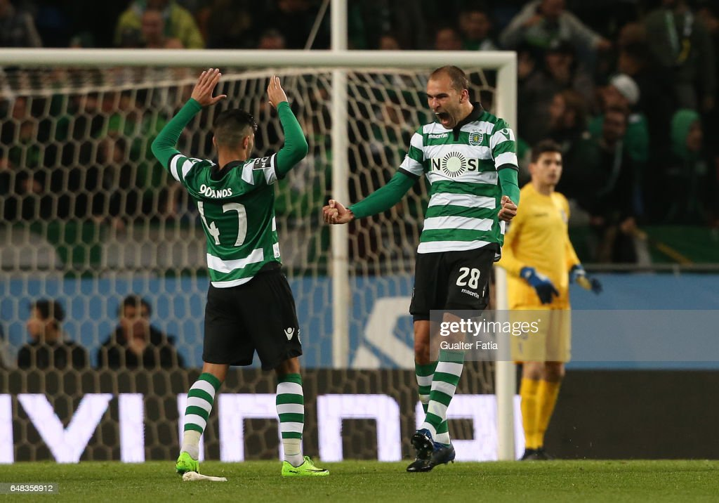 Sporting CPÕs forward Bas Dost from Holland celebrates with Sporting CPÕs defender Ricardo Esgaio after teammate Sporting CPÕs forward Alan Ruiz from Argentina scored a goal during the Primeira Liga match between Sporting CP and Vitoria Guimaraes at Estadio Jose Alvalade on March 5, 2017 in Lisbon, Portugal.