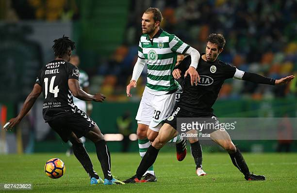 Sporting CP's forward Bas Dost from Holland with Vitoria de Setubal's defender Frederico Venancio and Vitoria de Setubal's midfielder Mikel Agu in...