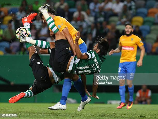 Sporting CP's forward Bryan Ruiz from Costa Rica and Sporting CP's forward Alan Ruiz from Argentina with Estoril's defender Joao Afonso during the...