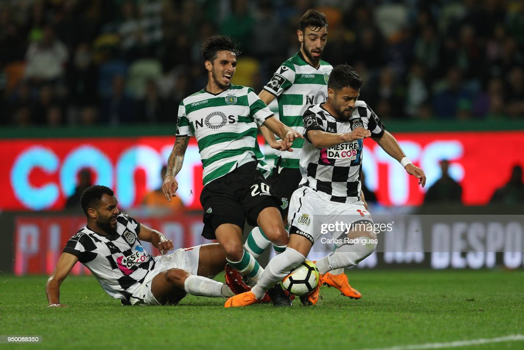 Sporting CPÕs forward Bryan Ruiz from Costa Rica (C) vies with Boavista FC defender Robson from Brazil (L) and Boavista FC midfielder Carraca from Portugal (R) for the ball possession during the Portuguese Primeira Liga match between Sporting CP and Boavista FC at Estadio Jose Alvalade on April 22, 2018 in Lisbon, Lisboa.