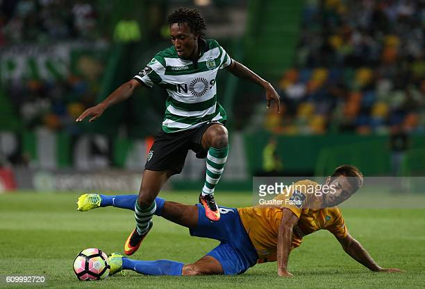 Sporting CP's forward Gelson Martins with Estoril's midfielder Afonso Taira from Portugal in action during the Primeira Liga match between Sporting...