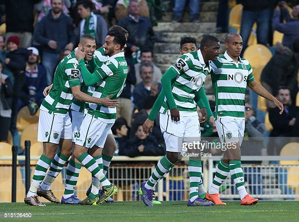 Sporting CP's forward Islam Slimani from Algeria celebrates with teammates after scoring a goal during the Primeira Liga match between GD Estoril...