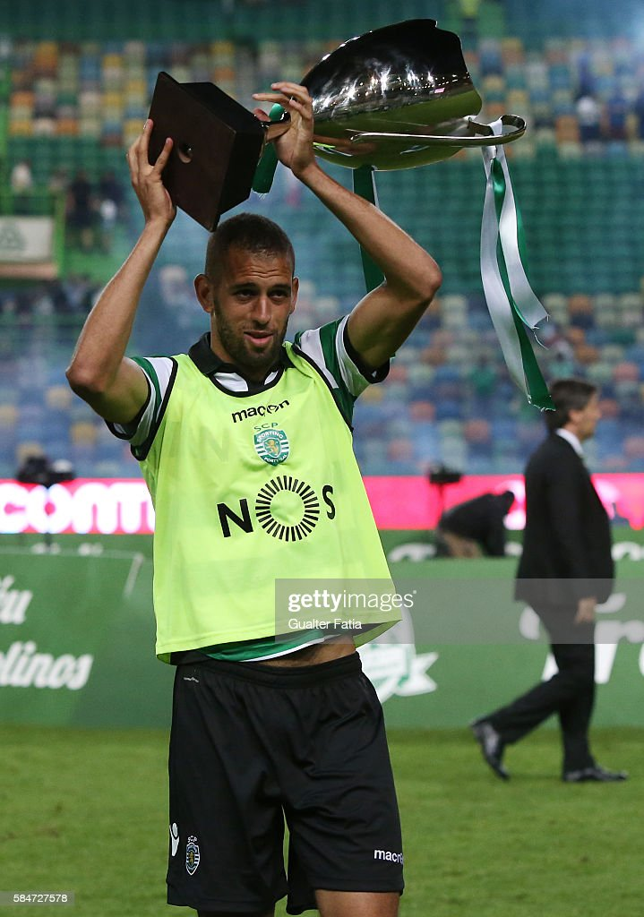 Sporting CP's forward Islam Slimani from Algeria celebrates with trophy after winning the Cinco Violinos Trophy at the end of the Pre Season Friendly match between Sporting CP and Wolfsburg at Estadio Jose Alvalade on July 30, 2016 in Lisbon, Portugal.