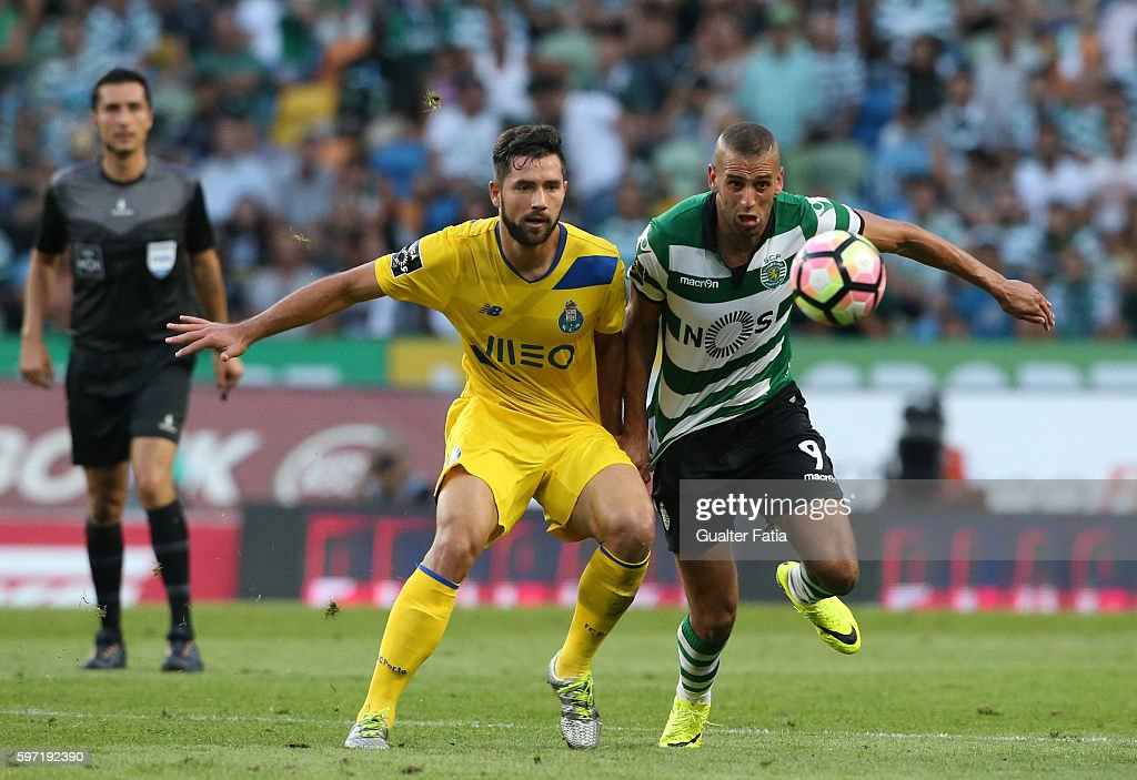 Sporting CP's forward Islam Slimani from Algeria tackled by FC Porto's defender from Brazil Felipe in action during the Primeira Liga match between Sporting CP and FC Porto at Estadio Jose Alvalade on August 28, 2016 in Lisbon, Portugal.