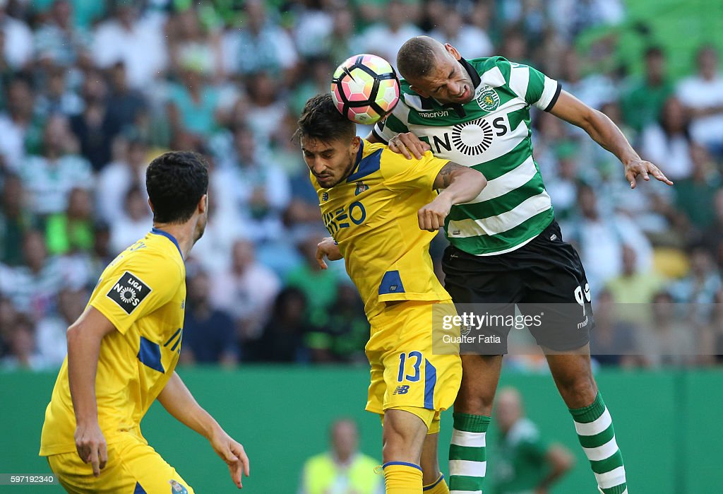 Sporting CP's forward Islam Slimani from Algeria with FC Porto's defender from Brazil Alex Telles in action during the Primeira Liga match between Sporting CP and FC Porto at Estadio Jose Alvalade on August 28, 2016 in Lisbon, Portugal.