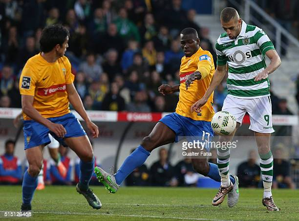 Sporting CP's forward Islam Slimani from Algeria with GD Estoril Praia's midfielder Anderson Esiti in action during the Primeira Liga match between...