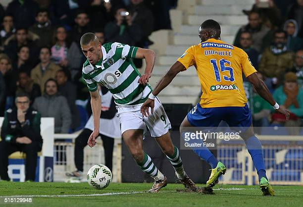 Sporting CPÕs forward Islam Slimani from Algeria with GD Estoril PraiaÕs defender Oumar Diakhite in action during the Primeira Liga match between GD...
