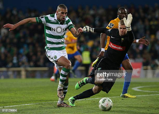 Sporting CPÕs forward Islam Slimani from Algeria with GD Estoril PraiaÕs goalkeeper Pawel Kieszek in action during the Primeira Liga match between GD...