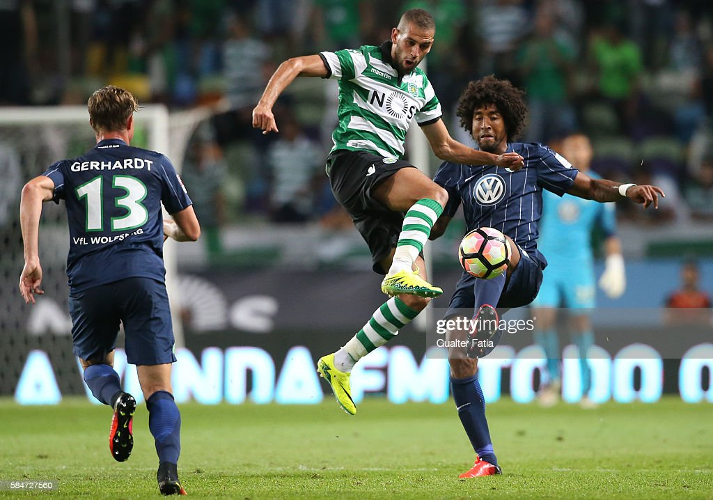 Sporting CP's forward Islam Slimani from Algeria with Wolfsburg's defender Dante in action during the Pre Season Friendly match between Sporting CP and Wolfsburg at Estadio Jose Alvalade on July 30, 2016 in Lisbon, Portugal.