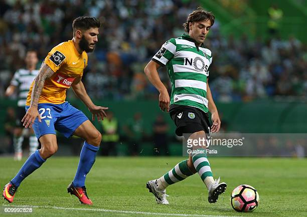 Sporting CP's forward Lazar Markovic from Serbia with Estoril's defender Lucas Farias from Brazil in action during the Primeira Liga match between...