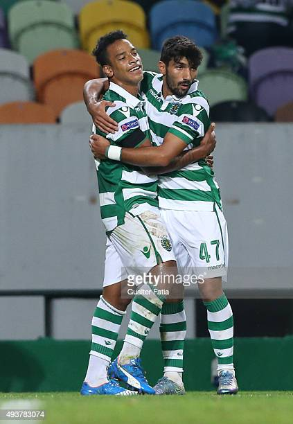 Sporting CP's forward Matheus Pereira celebrates with teammate Ricardo Esgaio after scoring a goal during the UEFA Europa League match between...