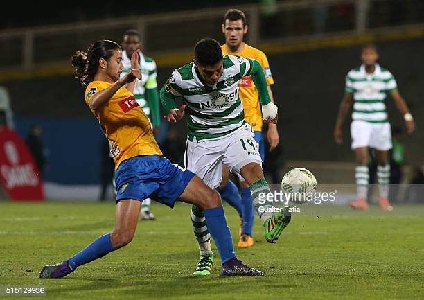 Sporting CPÕs forward Teofilo Gutierrez from Colombia tackled by GD Estoril PraiaÕs midfielder Mattheus Oliveira during the Primeira Liga match...