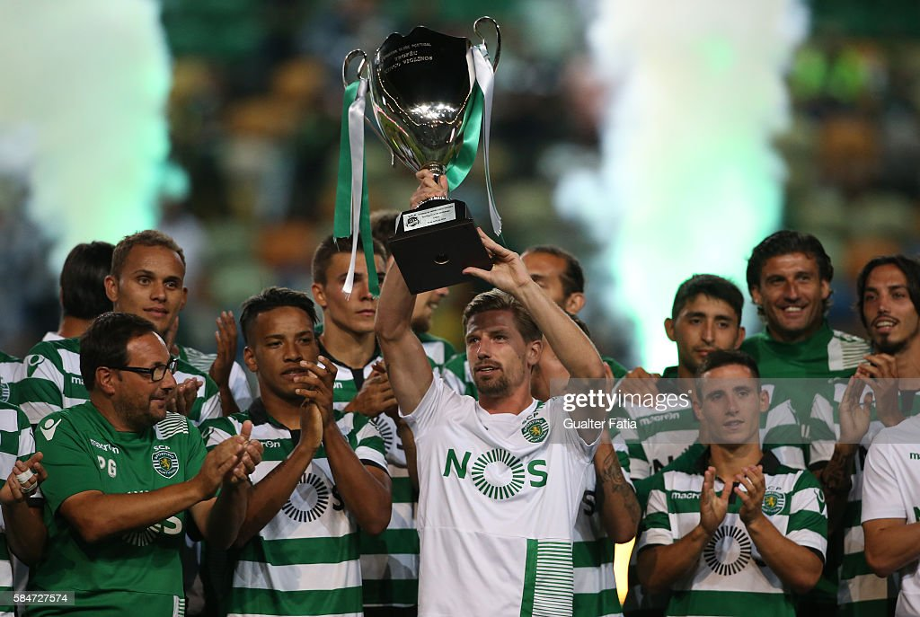 Sporting CP's midfielder Adrien Silva and teammates celebrate with trophy after winning the Cinco Violinos Trophy at the end of the Pre Season Friendly match between Sporting CP and Wolfsburg at Estadio Jose Alvalade on July 30, 2016 in Lisbon, Portugal.
