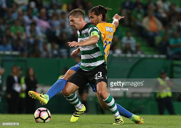 Sporting CP's midfielder Adrien Silva with Estoril's midfielder Mattheus Bebeto from Brazil in action during the Primeira Liga match between Sporting...