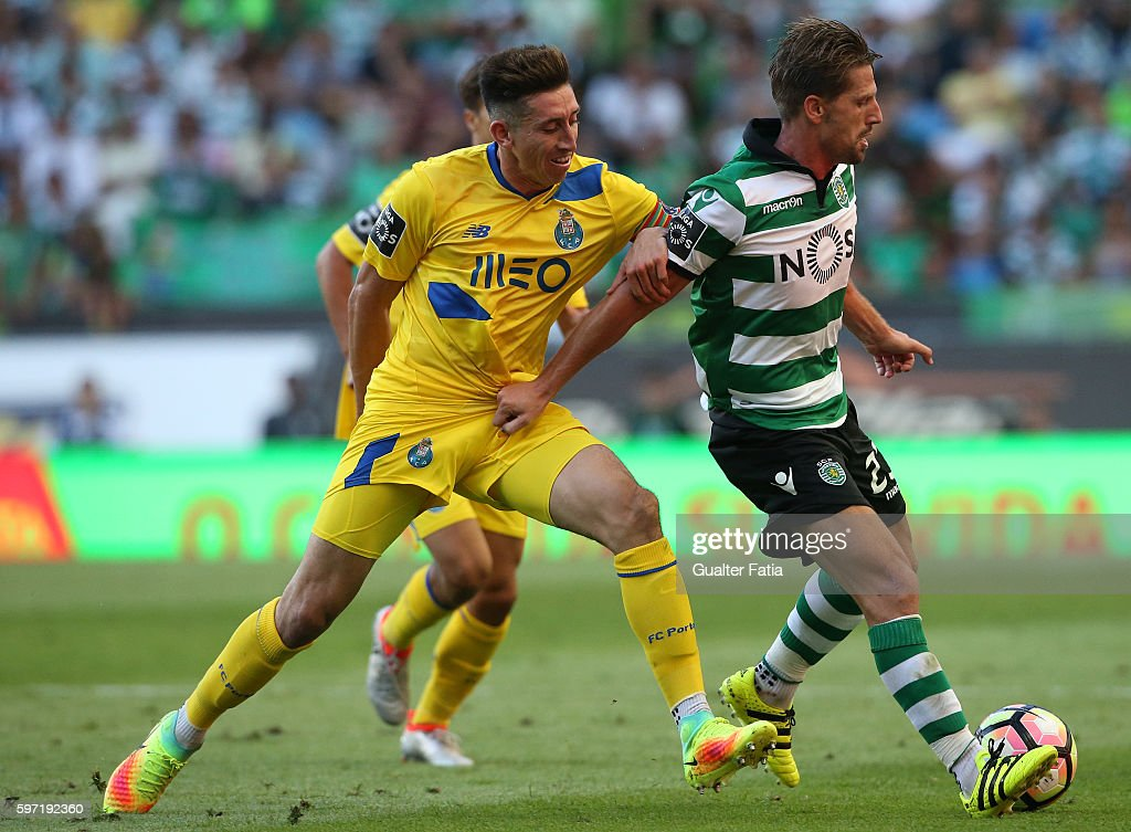 Sporting CP's midfielder Adrien Silva with FC Porto's midfielder from Mexico Hector Herrera in action during the Primeira Liga match between Sporting CP and FC Porto at Estadio Jose Alvalade on August 28, 2016 in Lisbon, Portugal.