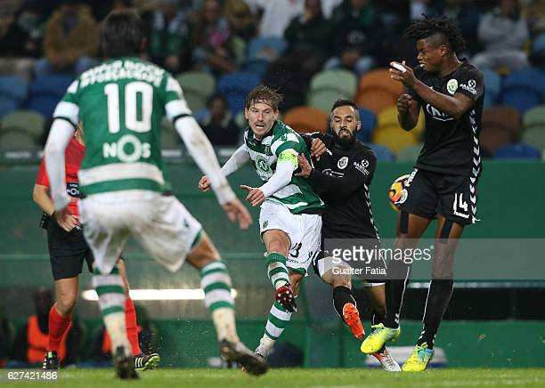 Sporting CP's midfielder Adrien Silva with Vitoria de Setubal's forward Joao Costinha in action during the Primeira Liga match between Sporting CP...