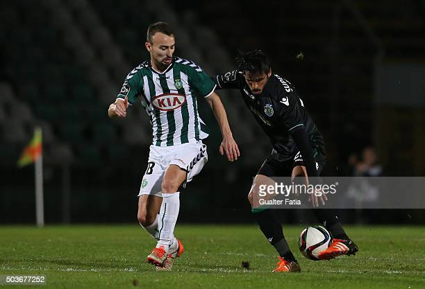 Sporting CPÕs midfielder Adrien Silva with Vitoria SetubalÕs forward Andre Claro in action during the Primeira Liga match between Vitoria Setubal and...