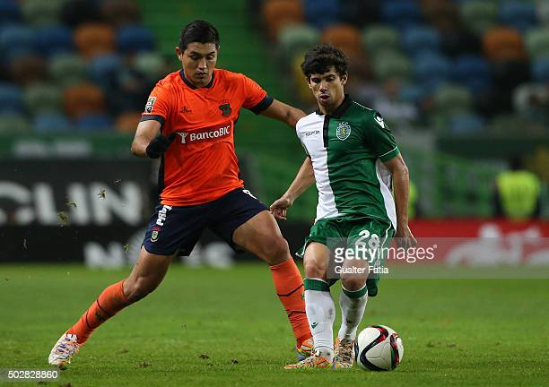 Sporting CP's midfielder Andre Martins with FC Pacos de Ferreira's midfielder Christian in action during the Taca da Liga match between Sporting CP...