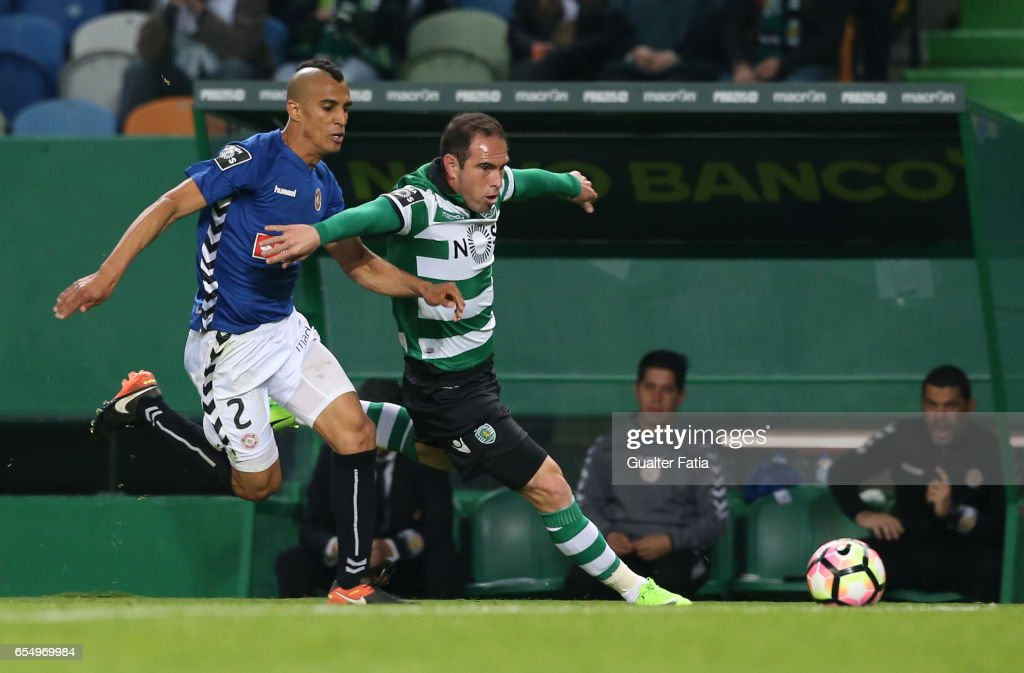 Sporting CP's midfielder Bruno Cesar from Brazil with Nacional's defender Victor Garcia from Venezuela in action during the Primeira Liga match between Sporting CP and CD Nacional at Estadio Jose Alvalade on March 18, 2017 in Lisbon, Portugal.