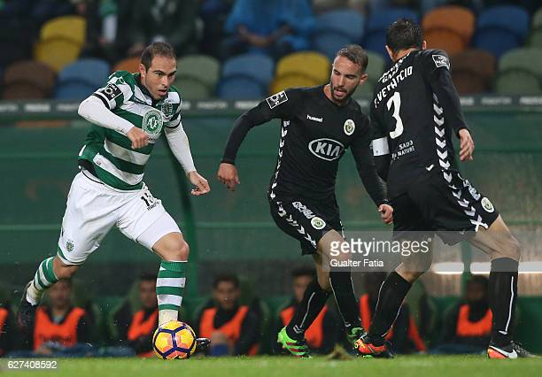 Sporting CP's midfielder Bruno Cesar from Brazil with Vitoria de Setubal's defender Pedro Pinto and Vitoria de Setubal's defender Frederico Venancio...