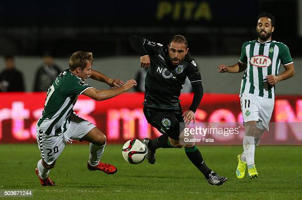 Sporting CPÕs midfielder Bruno Cesar with Vitoria SetubalÕs defender Toni Gorupec in action during the Primeira Liga match between Vitoria Setubal...