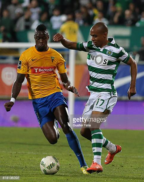 Sporting CPÕs midfielder Joao Mario with GD Estoril PraiaÕs forward Frederic Mendy in action during the Primeira Liga match between GD Estoril Praia...