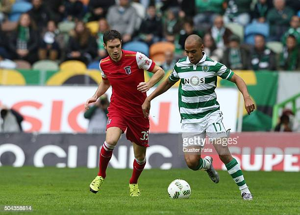 Sporting CP's midfielder Joao Mario with SC Braga's midfielder Nikola Vukcevic in action during the Primeira Liga match between Sporting CP and SC...