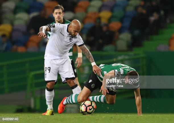Sporting CP's midfielder Joao Palhinha from Portugal tackled by Vitoria Guimaraes' forward Rafael Martins during the Primeira Liga match between...
