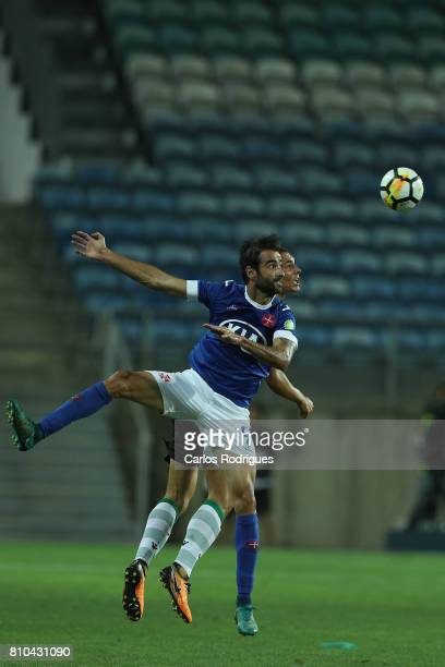 Sporting CP's midfielder Joao Palhinha from Portugal vies with Belenenses's forward Tiago Caeiro from Portugal during the PreSeason Friendly match...