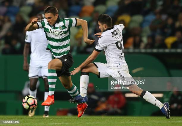 Sporting CP's midfielder Joao Palhinha from Portugal with Vitoria Guimaraes' midfielder Guillermo Celis in action during the Primeira Liga match...