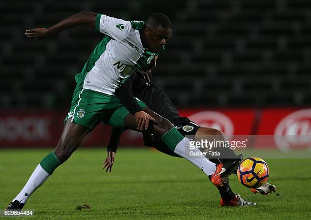 Sporting CP's midfielder William Carvalho with Vitoria de Setubal's forward Joao Costinha in action during Portuguese Cup match between Vitoria...