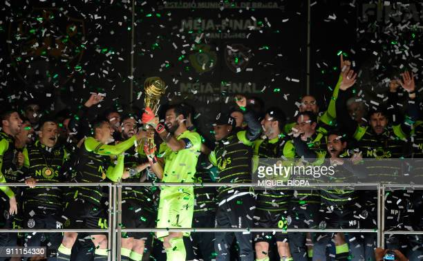 Sporting CP's players celebrate after winning the Portuguese Cup final football match between Vitoria FC and Sporting CP at the Municipal stadium of...