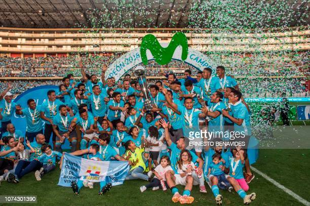Sporting Cristal players celebrate after winning the Descentralizado Tournament football final against Alianza Lima at the National Stadium in Lima...