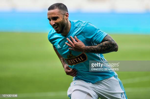 Sporting Cristal's Emanuel Herrera celebrates after scoring against Alianza Lima during the Descentralizado Tournament football final at the National...