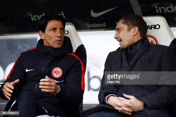 Sporting director Bruno Huebner of Frankfurt talks with financing director Oliver Frankenbach before the Bundesliga match between Eintracht Frankfurt...