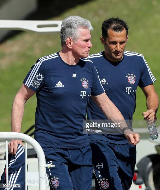 Sporting director Hasan Salihamidzic of Muenchen and Head coach Jupp Heynckes of Muenchen look on during the FC Bayern Muenchen training camp at...