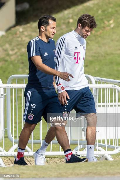 Sporting director Hasan Salihamidzic of Muenchen and Thomas Mueller of Muenchen look on during the FC Bayern Muenchen training camp at Aspire Academy...