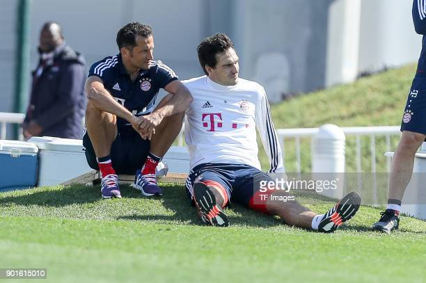Sporting director Hasan Salihamidzic of Muenchen speaks with Mats Hummels of Muenchen during the FC Bayern Muenchen training camp at Aspire Academy...