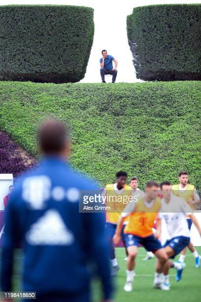 Sporting director Hasan Salihamidzic watches a training session on day six of the FC Bayern Muenchen winter training camp at Aspire Academy on...